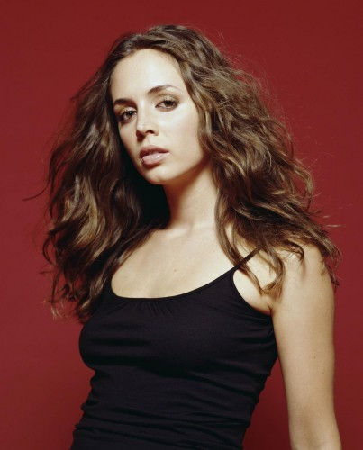 eliza dushku - black clothes red wall