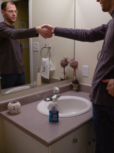 mirror hand shake 375x500 Mirror Hand Shake Visual Tricks