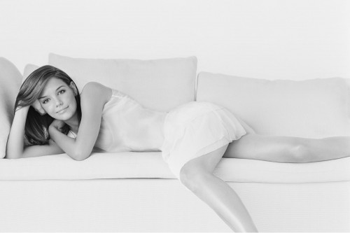 Katie Holmes - on a couch
