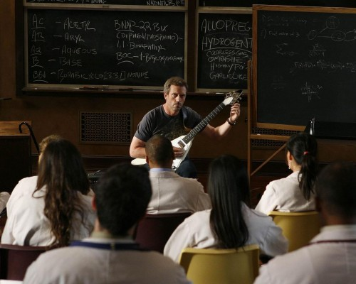 House Plays Guitar For His Students