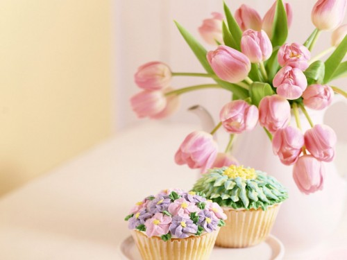 pink flowers and cup cakes