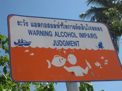 warning - alcohol impairs judgment - fish kisser