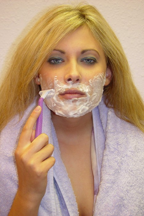 a woman shaving