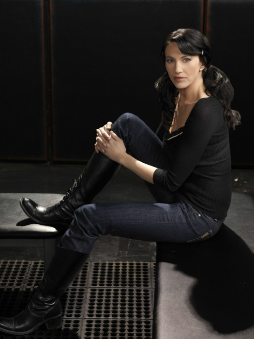 Claudia Black - sitting in jeans