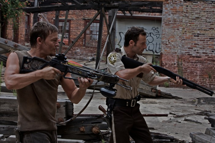 walking dead crossbow and shotgun 700x466 walking dead   crossbow and shotgun Wallpaper The walking dead Television