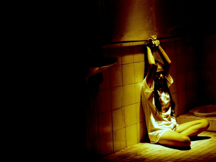 girl chained to wall