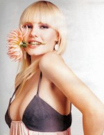 elisha cuthbert eating a flower 150x195 elisha cuthbert super post Wallpaper Television Sexy Movies
