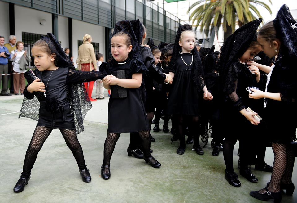 26 Young girls wore traditional black mantillas during a childrens procession at Our Lady of the Rosary school in Seville Spain