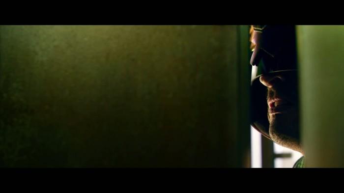 Judge Dredd through a door crack.jpg