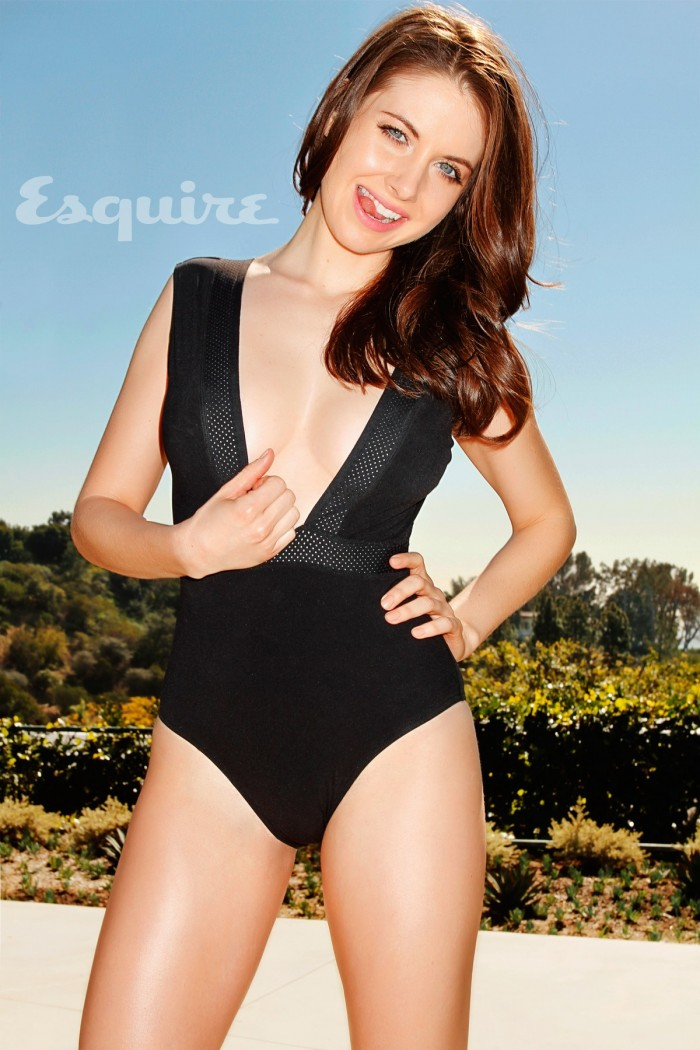 Alison Brie - Esquire - pulling down her top.jpg