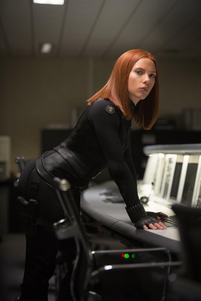 Black Widow bent over some data.jpg