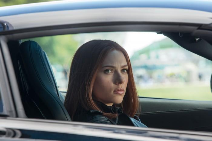 Black Widow in a sports car.jpg