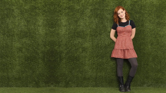 Emma on a green wall.jpg