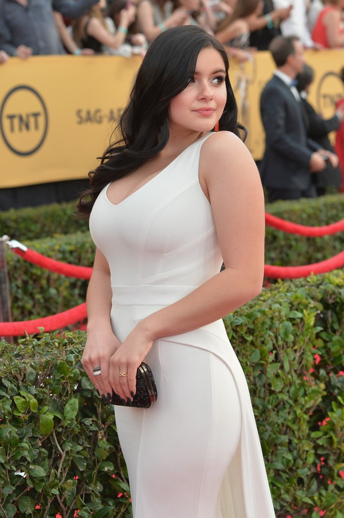 Ariel Winter in white dress looking back.jpg