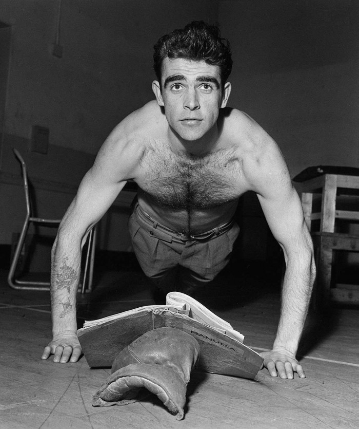 Sean Connery - doing push ups while reading.jpg
