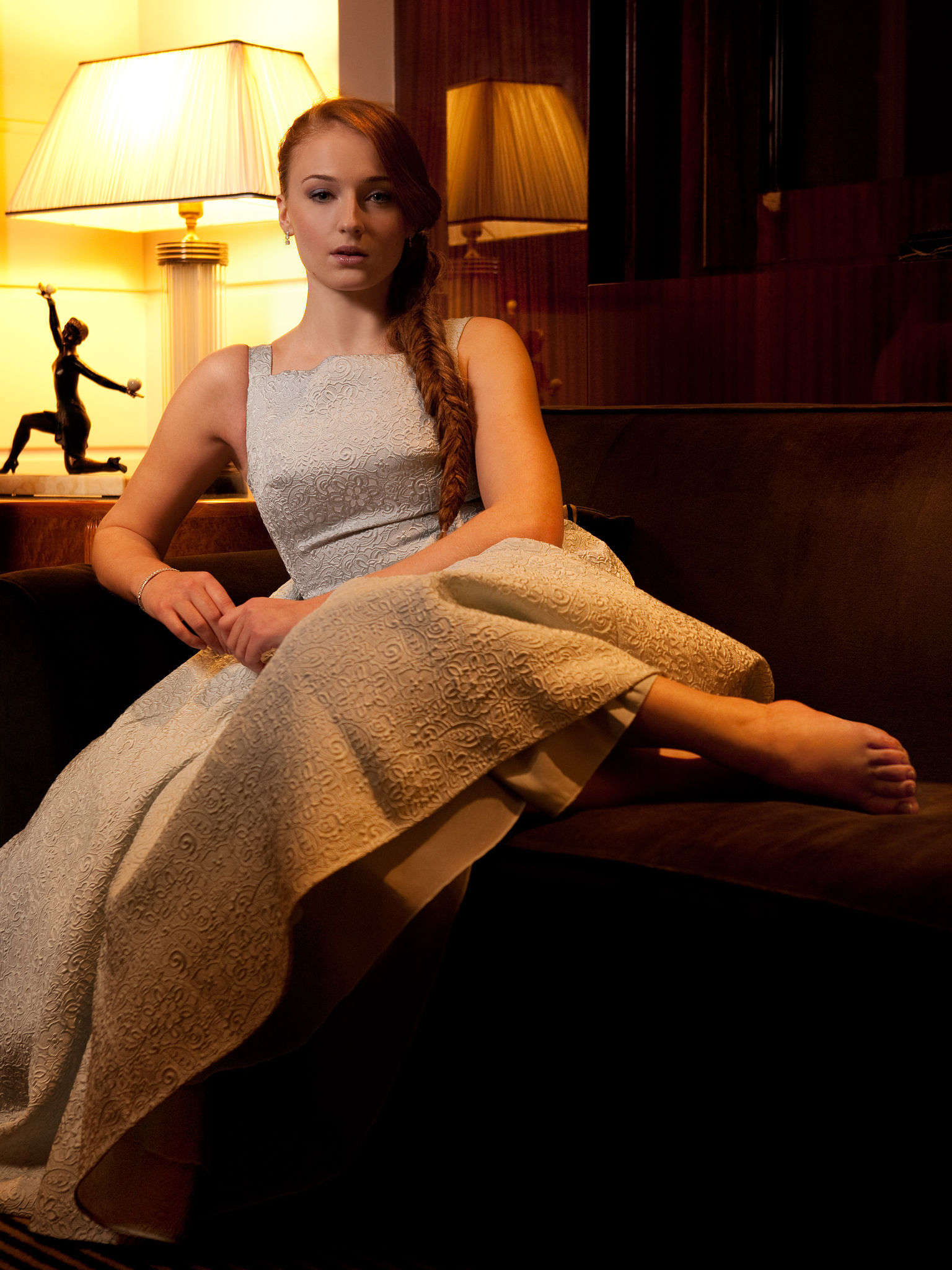 Sophie Turner on a couch.jpg