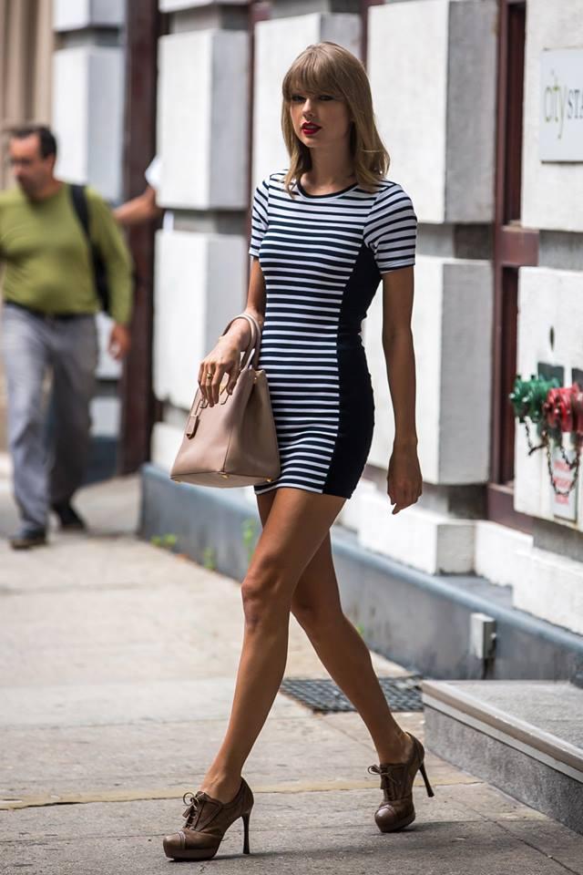 Taylor Swift in a clown dress.jpg