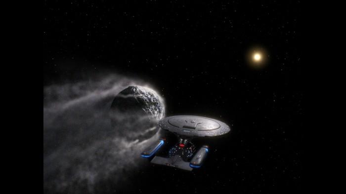 The Enterprise 1701-D Rides Shotgun to an astroid.jpg