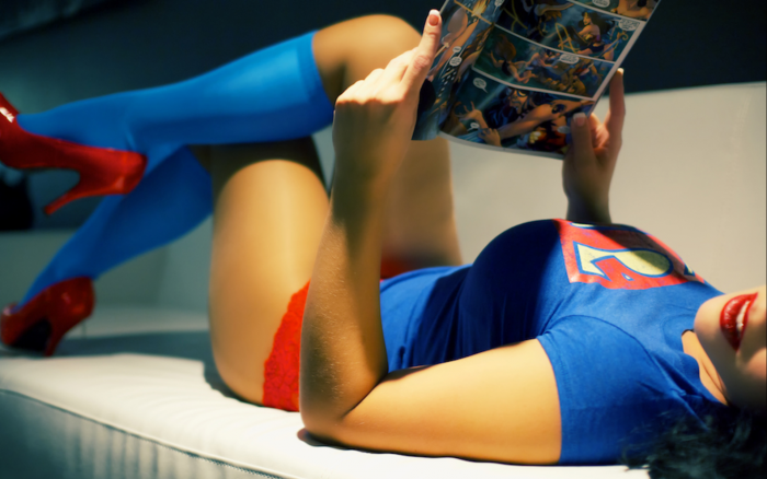 Supergirl enjoys some comics 700x438 Supergirl enjoys some comics Wallpaper supergirl Sexy NeSFW cosplay Comic Books