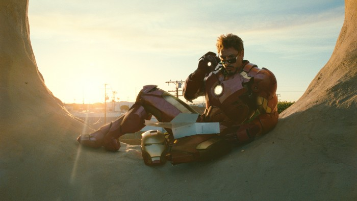 Iron man eats some donuts 700x394 Iron man eats some donuts Wallpaper Movies Iron Man Comic Books
