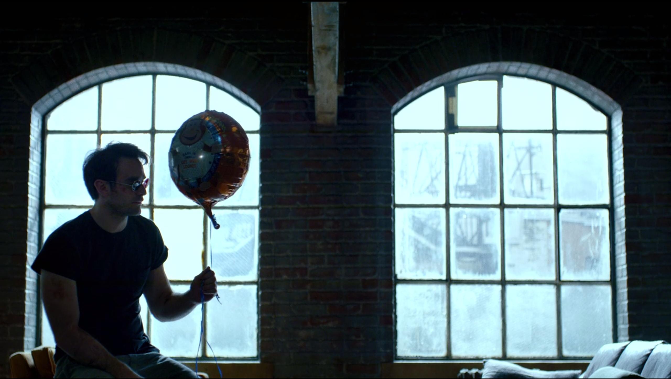 Matt with a balloon.png