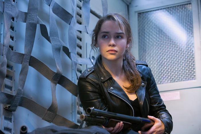 Emilia Clark with a shotgun.jpg