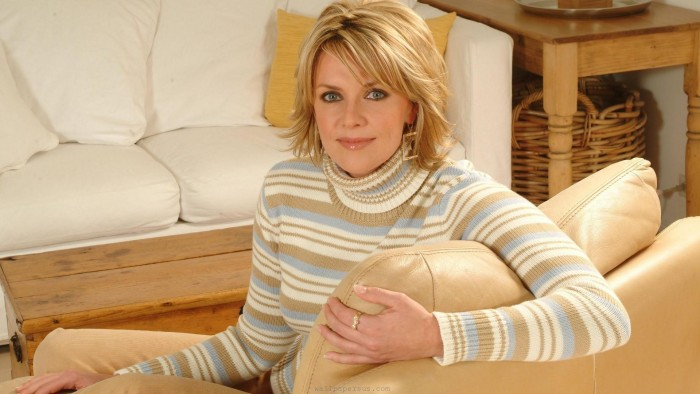 Amanda Tapping on a couch.jpg