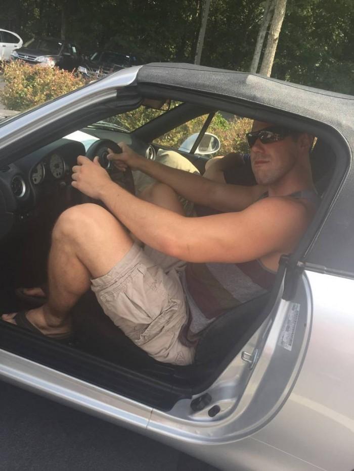 big guy in a tiny car.jpg