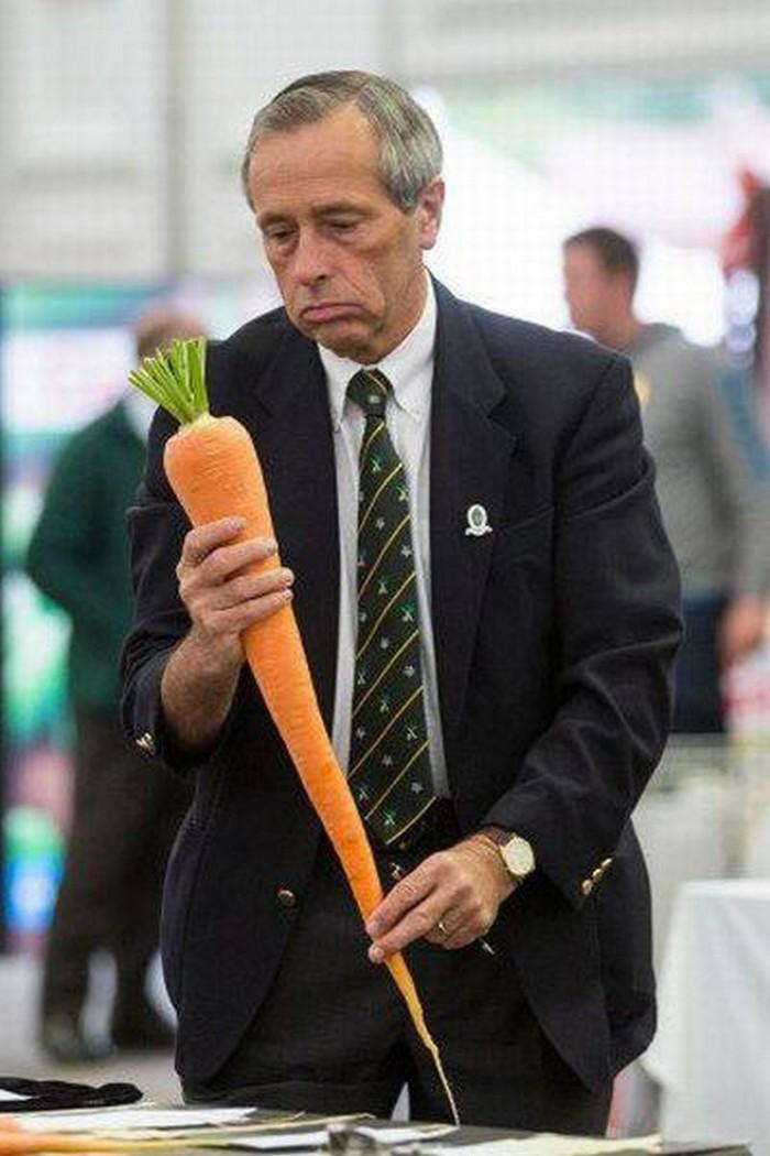 Sad man wiht a large carrot.jpg