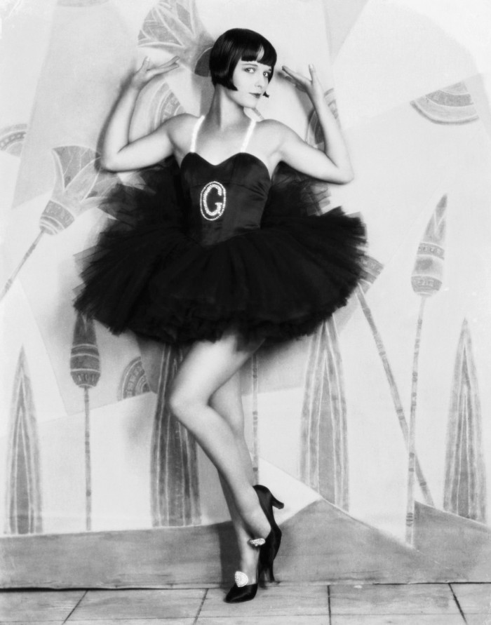 "1927: American actress Louise Brooks (1906 - 1985) wearing a frilly dress with a large G on the front for the film ""Now We're In The Air"". (Photo by Eugene Robert Richee)"