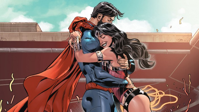 Bearded Superman gets a hug from wonder woman.jpg