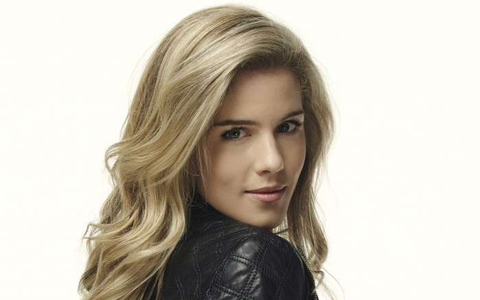 Emily Bett Rickards in a leather jacket.jpg