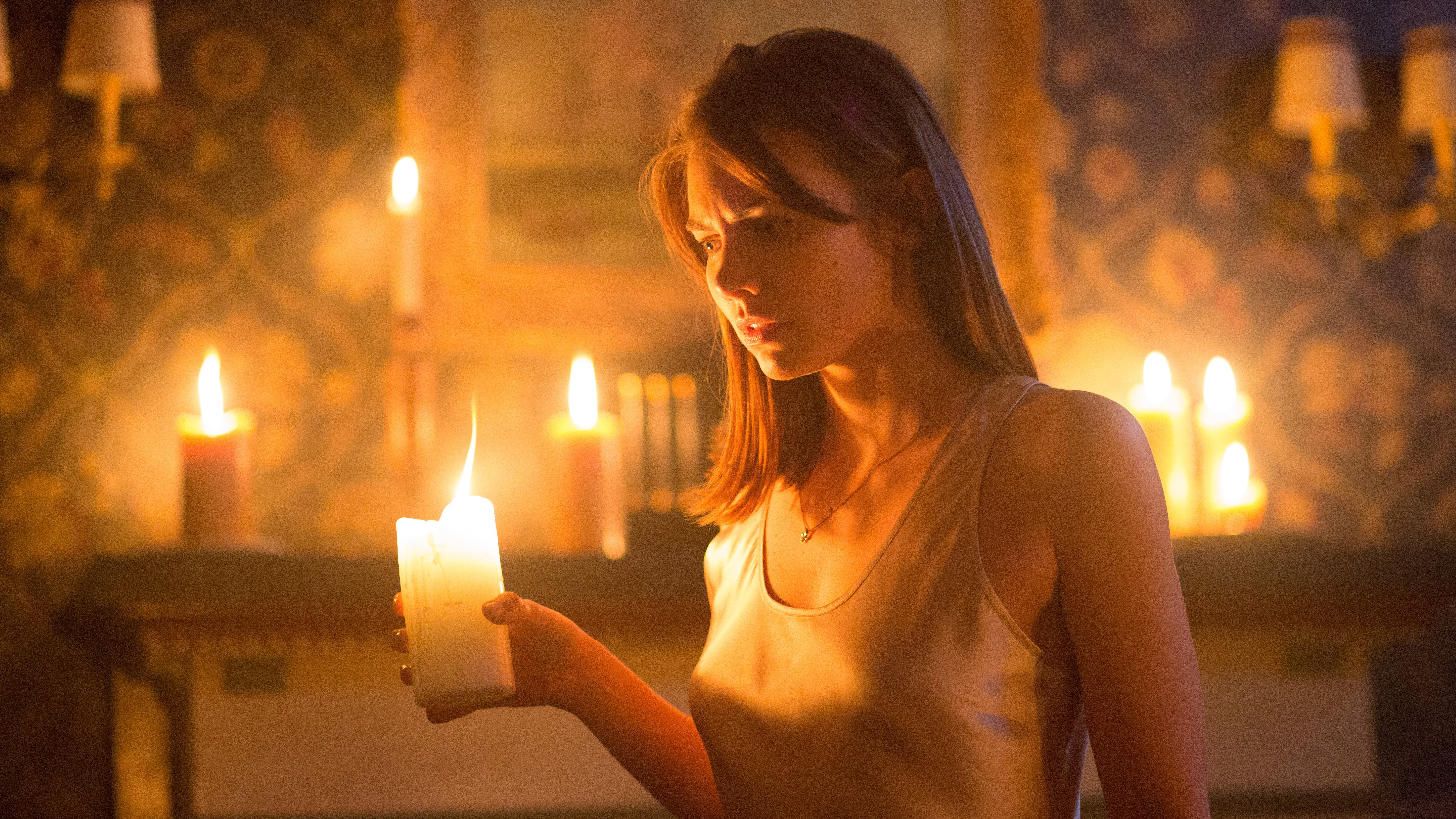 Lauren Cohan with a candle.jpg
