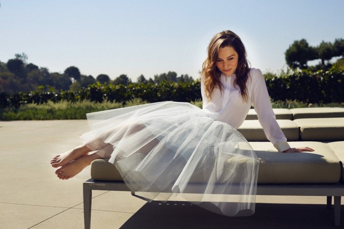 Emilia Clarke in a white dress.jpg