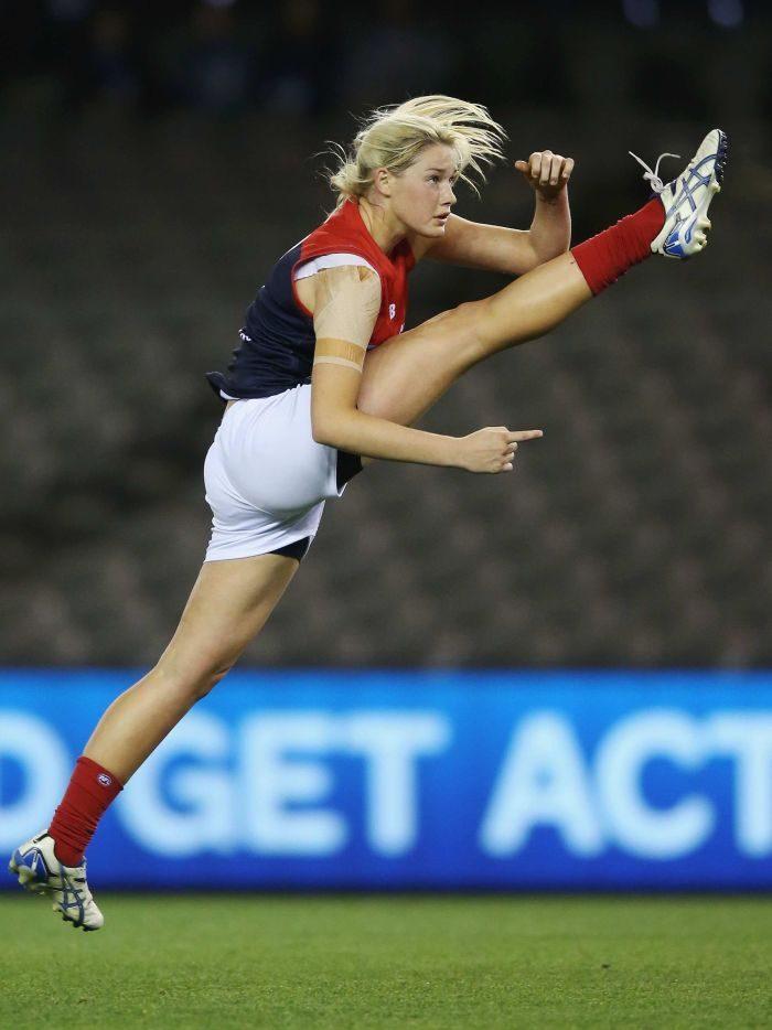 AFL player Tayla Harris mid-kick.jpeg