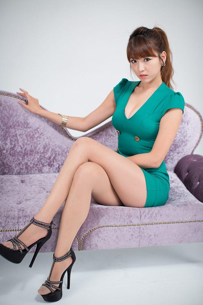 Asian in green Dress on Purple couch.jpg
