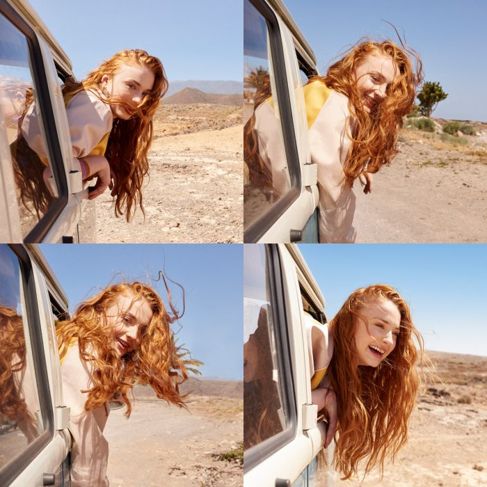 Sophie Turner hanging out of a car.jpg