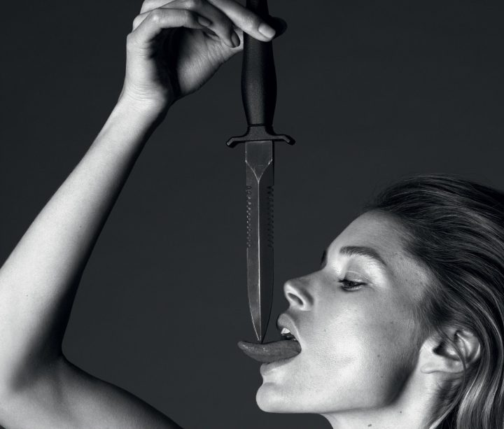 Doutzen Kroes licking a knife.jpg