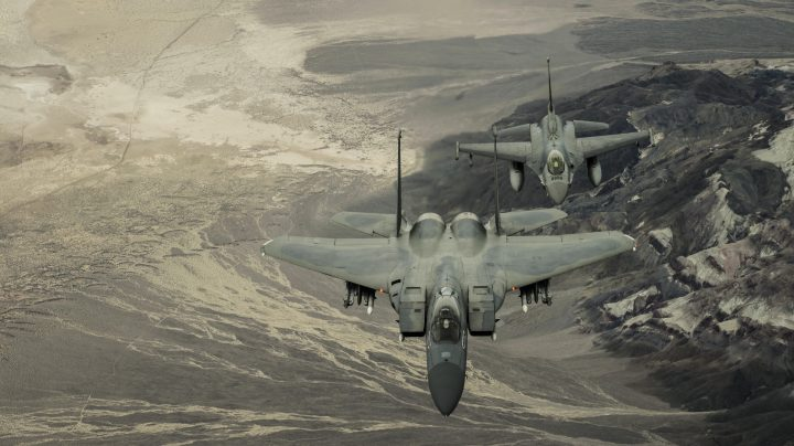 two fighter jets over mountains.jpg