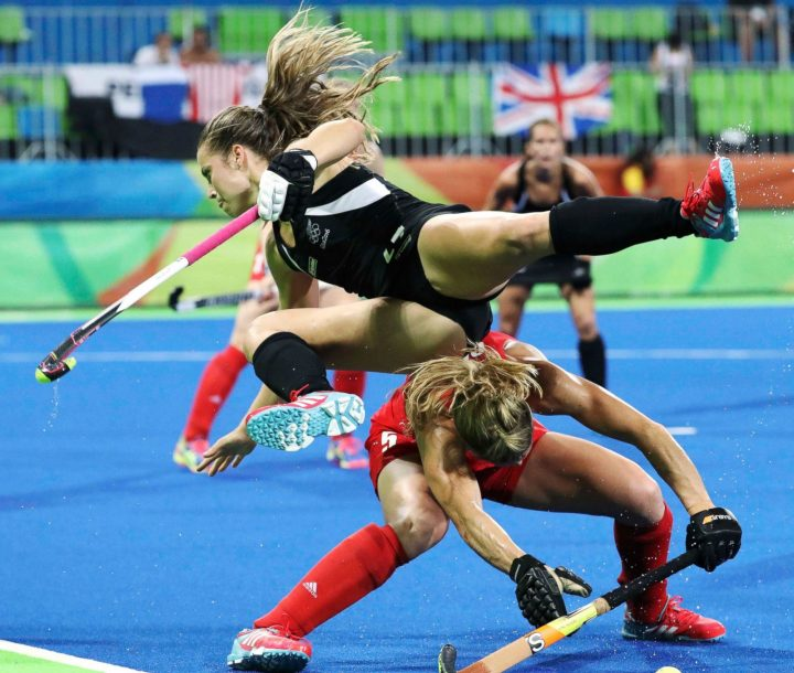 Rose Keddell of New Zealand (top) stumbles over Crista Cullen of Great Britain.jpg