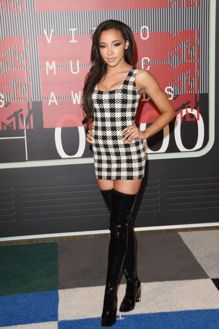 Tinashe in black boots and short dress.png