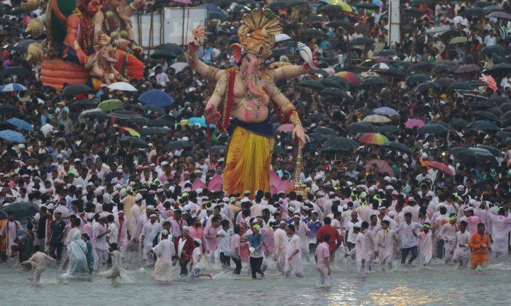 Devotees prepare to immerse an idol of elephant-headed Hindu god Ganesha in the Arabian Sea.jpg