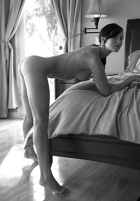 asian bent over her bed.jpg
