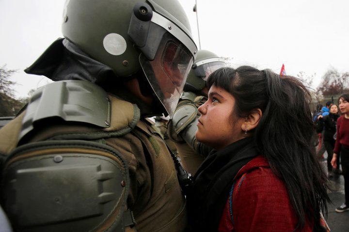 demonstrator stares down a riot policeman.jpg