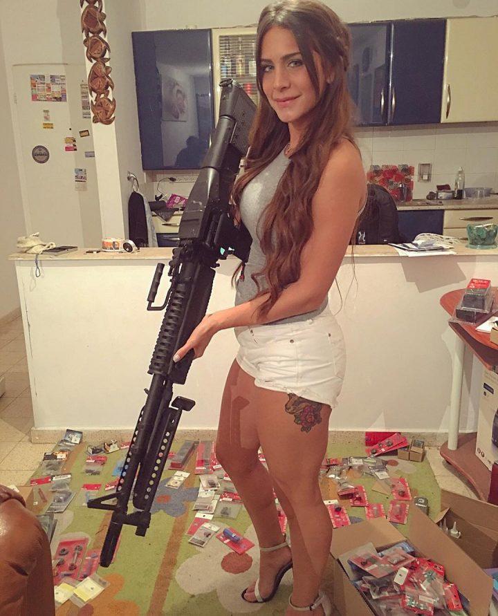 well armed woman in heels.jpg