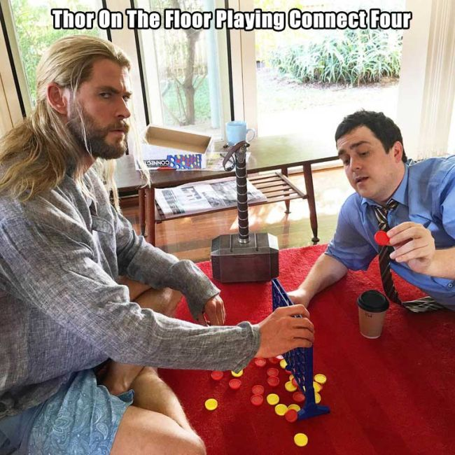 thor on the floor playing connect four.jpg