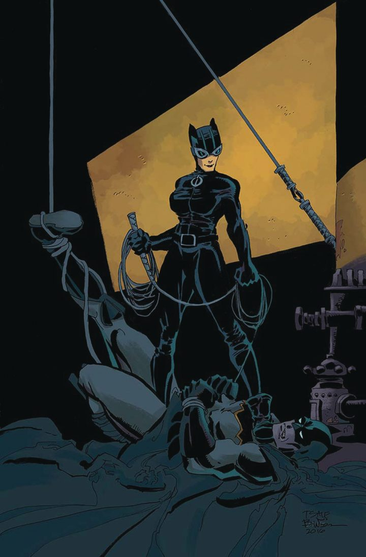 catwoman has batman tied up.jpg