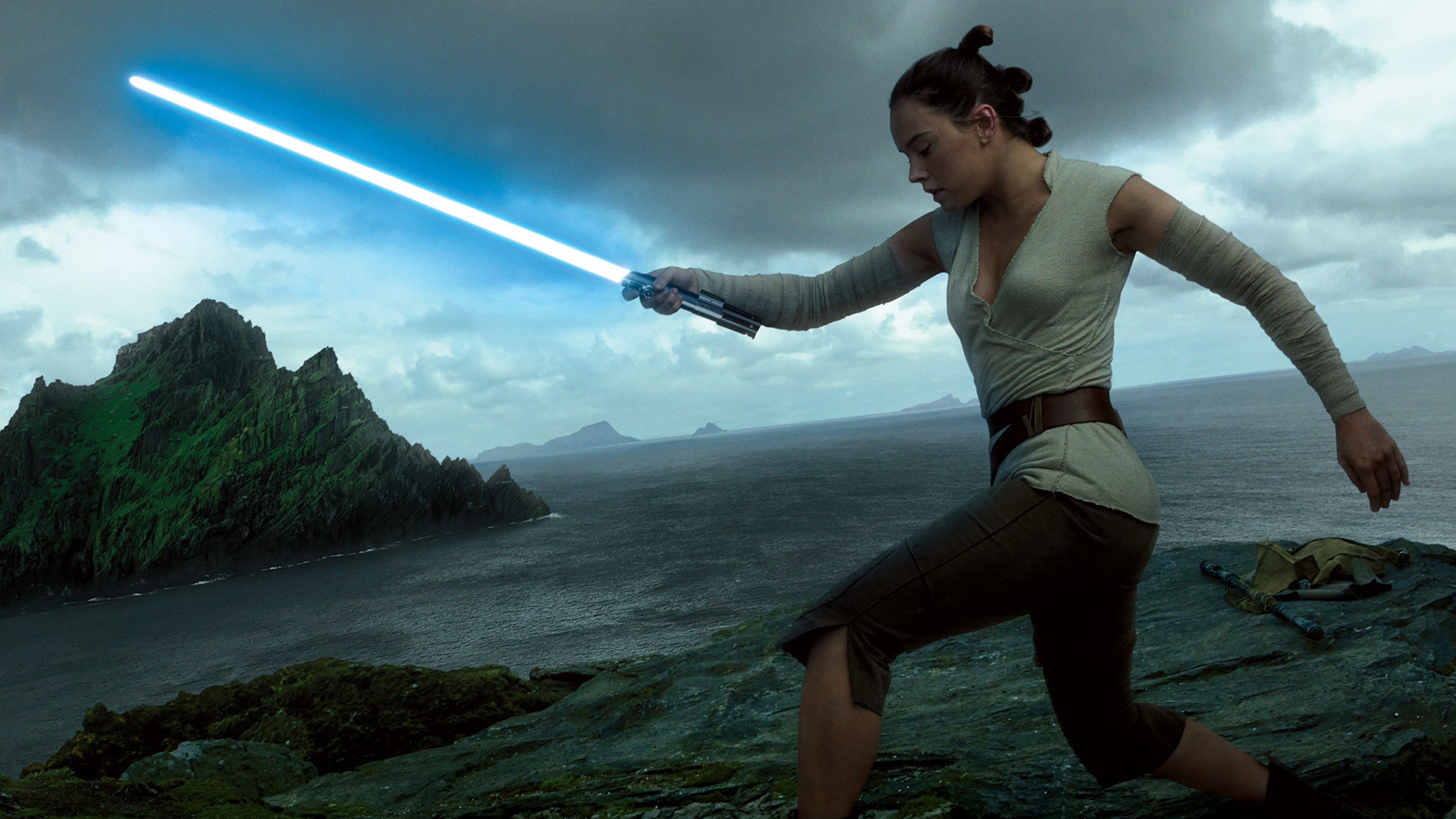 Rey and Light Saber