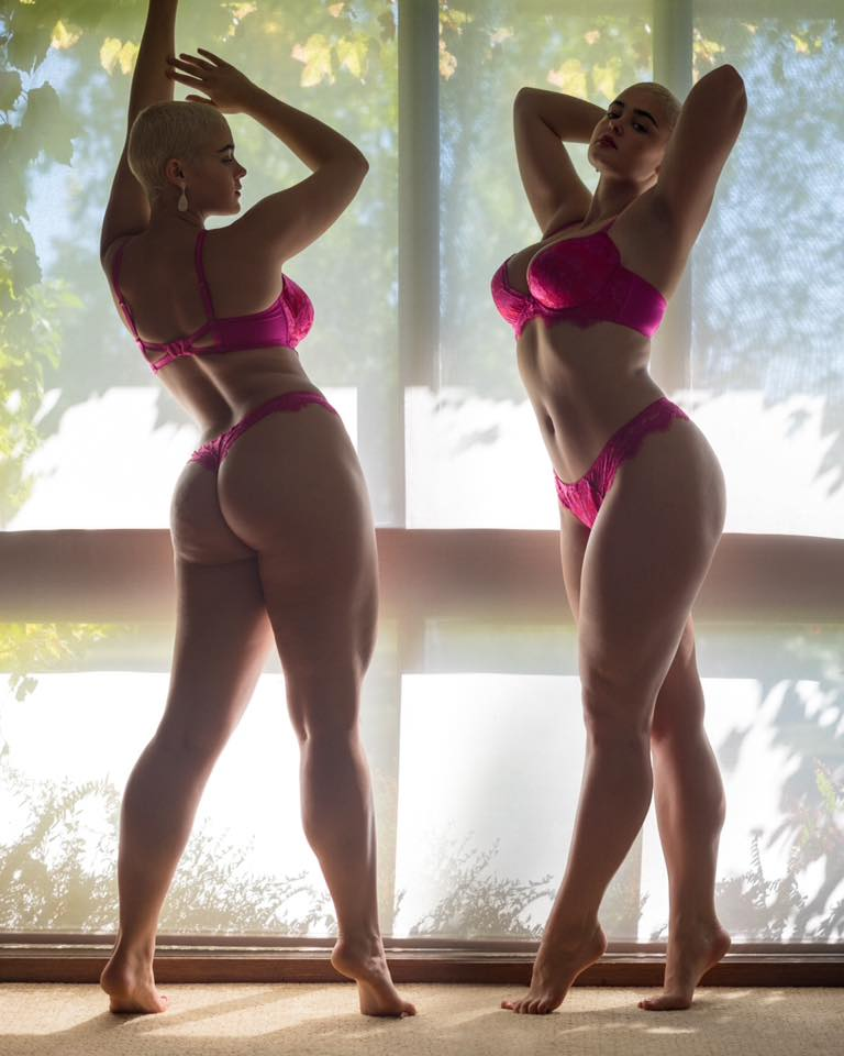 Stefania Ferrario stretching in pink.jpg