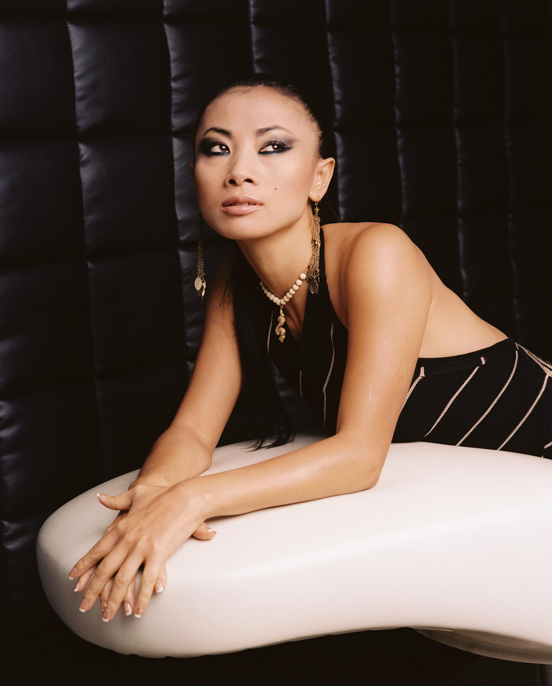 Bai Ling on her belly